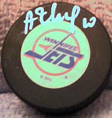 Alexei Zhamnov autographed Winnipeg Jets puck