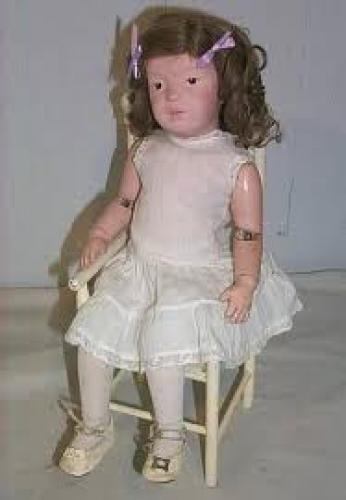 Antique Wooden Doll; Rocking Chair