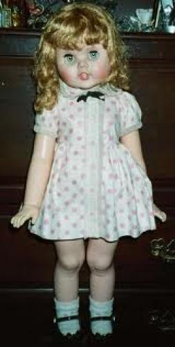 "Dolls; ""Toodles"" is from the early 1960's and is well-known for eyes that follow"