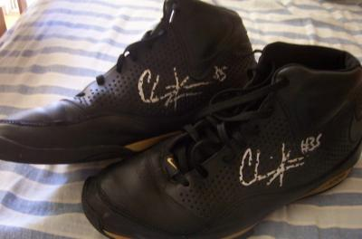 Chris Kaman autographed game worn pair of Nike Zoom shoes