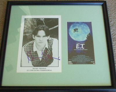 Henry Thomas autographed E.T. 8x10 photo matted & framed with video cover