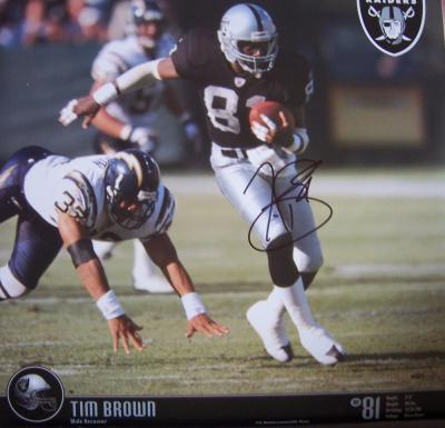 Tim Brown autographed Oakland Raiders calendar page