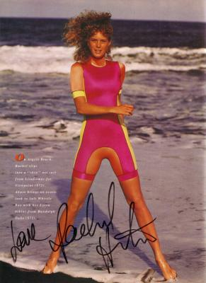 Rachel Hunter autographed Sports Illustrated swimsuit issue full page photo