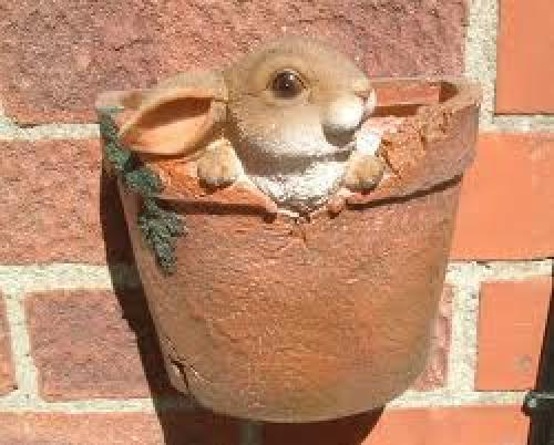 A decorative wall hanging plant pot with a 3D Rabbit sitting
