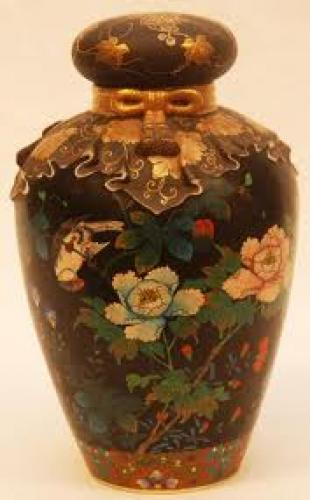 Antiques; Stunning antique vase has an incredible design