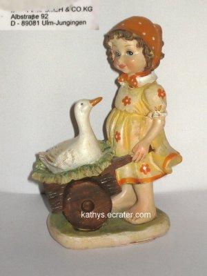 People: Germany Goose Girl w Scarf Wheelbarrow Resin Figurine